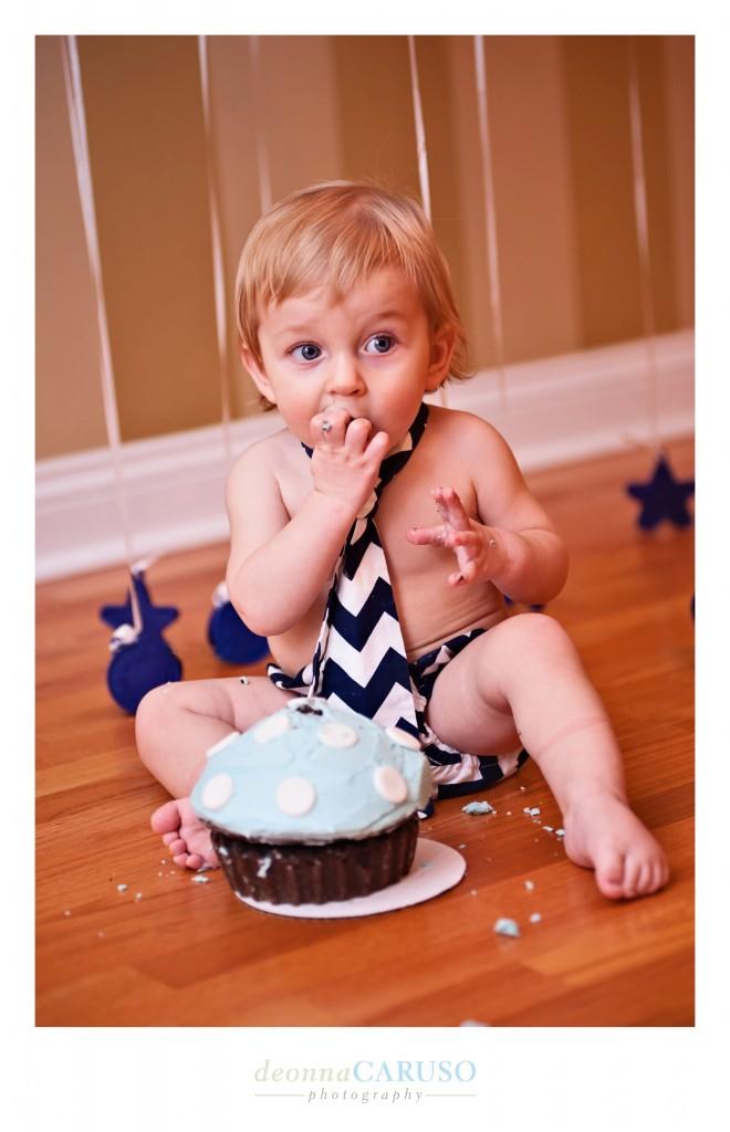 Every child enjoys his first birthday cake!